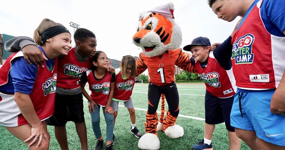 Kids and Bengals mascot huddled