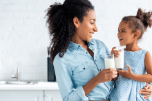 mom-and-daughter-drinking-milk