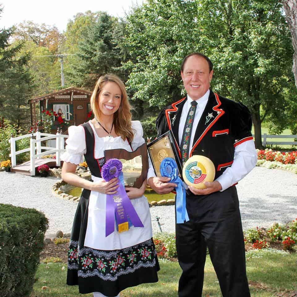 Ursula and Richard Guggisberg holding prize-winning cheese