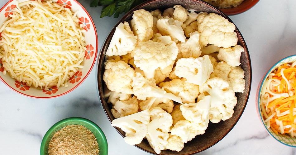 Cheesy Cauliflower Casserole ingredients in prep bowls