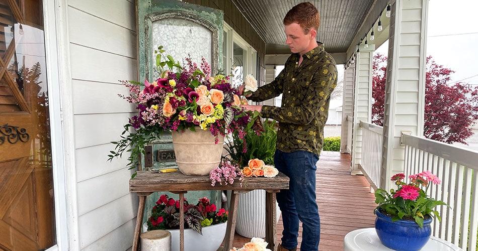 Keaton Topp working on a flower arrangement